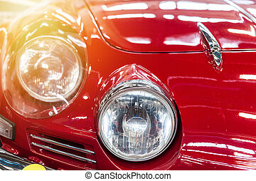 Headlight of a red car