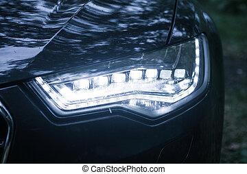 headlight of modern car - headlight of modern black car...