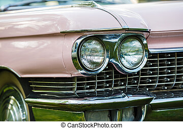 Headlight of pink vintage car