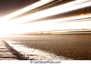 Headlights - A slow shutter night shot of a roadway with...