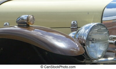 Headlights and Horn of Vintage Car. - Pan shot the front of...