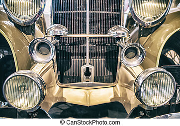 Headlights and horns on a classic car