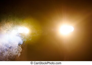Headlights of a car in smoke