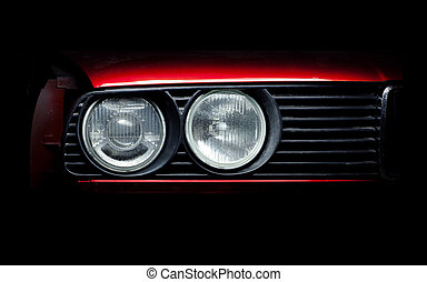 Headlights of the old red car close-up photo