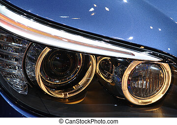 Headlights - Front headlights of a luxurious sports cars. No...