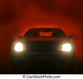 Headlights - Bright headlights on car. Red background