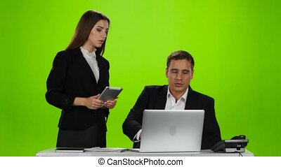 Headmistress praised his employee for the work done. Green screen