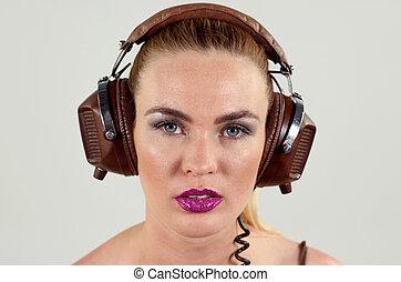 headphone girl - beautiful woman dj wearing retro headphones