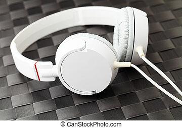 Headphone on black mat