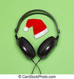 Headphones and Santa hat. Christmas songs minimal concept