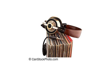 Headphones and vinyl records. - Retro headphones for...