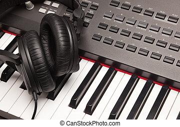 Headphones Laying on Electronic Keyboard