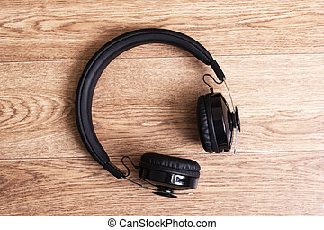 Headphones on a wooden table close up