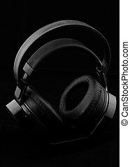 Headphones on black background