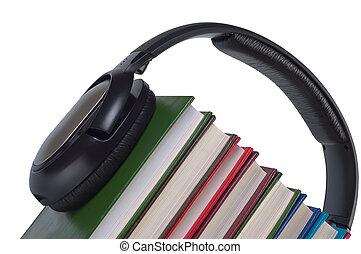Headphones on books close up.