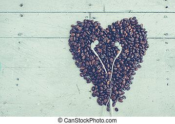 Headphones on heart shape coffee beans