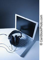 Headphones on laptop computer.