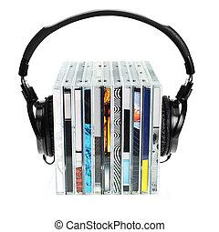 Headphones on stack of CDs - HI-Fi headphones on stack of...