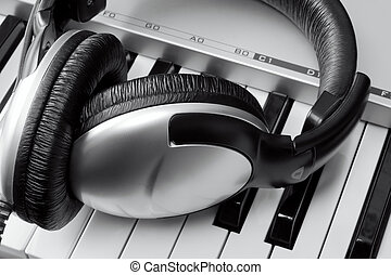 Headphones on synthesizer keyboard