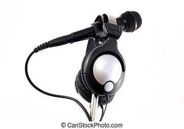 headphones - black microphone with headphones on a white...