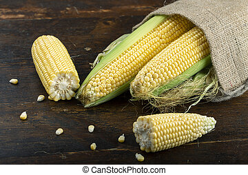 heads of corn on the table