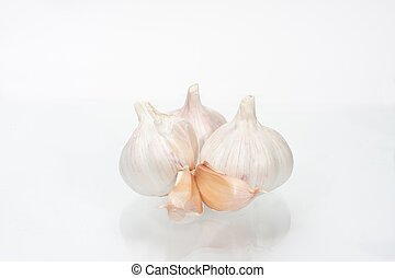 heads of garlic on a white