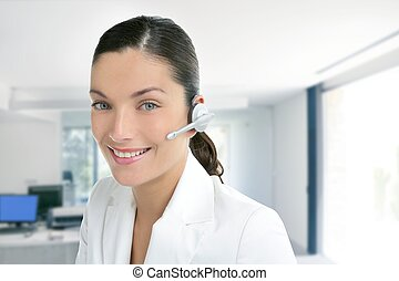 Headset phone business woman dress in white indoor modern...