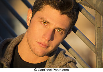 Headshot of attractive young man at sunset - Headshot of...
