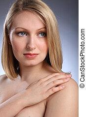 Headshot of beautiful blonde woman looking sad