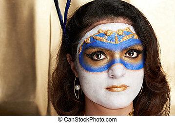 headshot of woman with mask