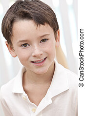 Headshot Portrait Of A Happy Smiling Young Boy