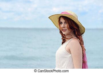 headshot redhead woman by the ocean