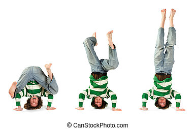 An adolescent attempting and succeeding at performing a headstand