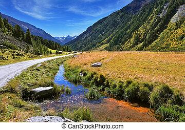 Headwaters Krimml waterfalls - Hillsides picturesque alpine...