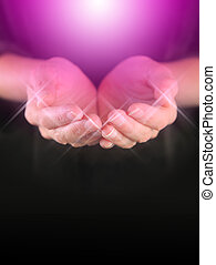 Healer with Magenta Healing Energy - female holding hands in...