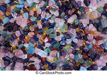Healing Chakra Crystals Banner - Chakra colored tumbled healing stones. Crystal healing background