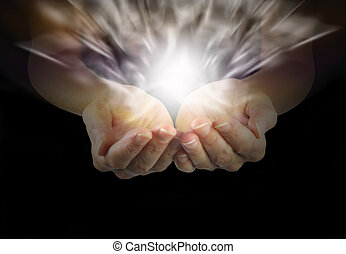 Woman with cupped hands emerging from dark and healing energy