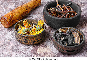 Healing gathering roots and herb - pestle and three mortar...