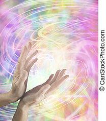 Healing hands and energy swirls - Female hands reaching up...
