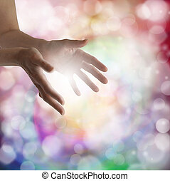 Woman's outstretched healing hands with light bokeh background and energy ball