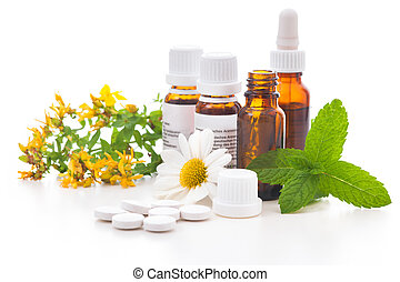 Alternative medicine - Healing herbs and medicinal bottles. ...