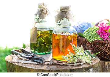 Healing herbs in bottles as an alternative cure