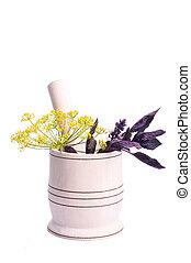 Healing herbs in ceramic mortar