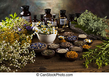 Healing herbs on wooden table, mortar and herbal medicine - ...