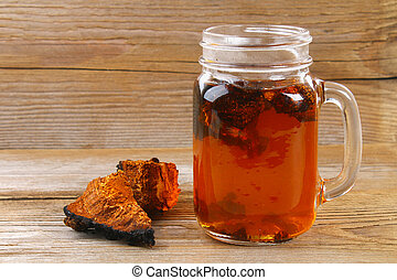 Healing tea from birch mushroom chaga is used in folk...