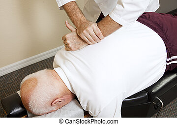 Healing Touch - Closeup of chiropractors hands doing spinal...