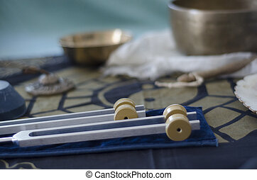 Healing Tuning forks. - A wo healing tuning forks with...