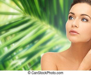 woman touching her face skin