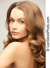 beautiful woman with long hair - health and beauty concept -...