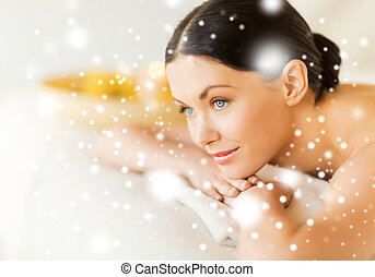 woman in spa - health and beauty concept - woman in spa...